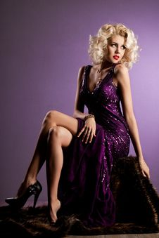 Woman In Violet Clothes Royalty Free Stock Images