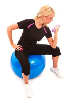 Arm Curl On Gym Ball Royalty Free Stock Photography