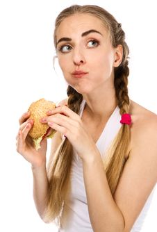 Free Young Woman Holding A Hamburger And An Apple Stock Photos - 20253033