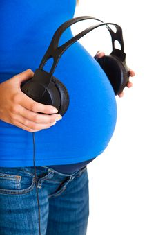 Free Pregnant Woman With Headphones Royalty Free Stock Photo - 20254065