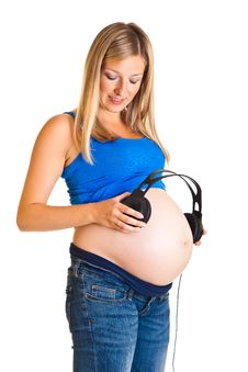 Free Pregnant Woman With Headphones Royalty Free Stock Image - 20254126