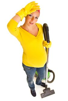 Free Pregnant Woman Clean With Vacuum Stock Photography - 20254762