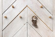 Set Of Keys On Wooden Wall Stock Image