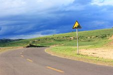 Landscape  Of  Road With Signpost In The Grassland Stock Photo