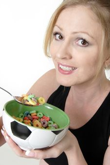 Free Woman Enjoying A Bowl Of Cereal Stock Image - 20263661