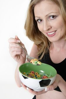 Free Woman Eating A Bowl Of Cereal Royalty Free Stock Image - 20263666