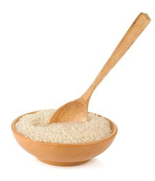 Rice In Wooden Plate And Spoon Isolated On White Stock Photos