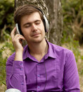 Free Men With Headphones At The Park Royalty Free Stock Photos - 20276098