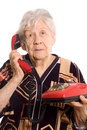 Free The Elderly Woman Speaks On Phone Royalty Free Stock Photography - 20277997