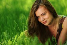 Free Brunette Lying On Green Grass Royalty Free Stock Image - 20275906