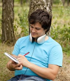 Free Student With Notebook And Headphones. Stock Images - 20276114
