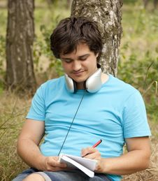 Free Student With Notebook And Headphones. Royalty Free Stock Images - 20276129