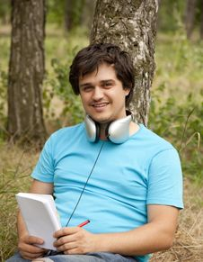 Free Student With Notebook And Headphones. Stock Image - 20276131