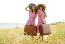 Free Girls With Suitcases At Countryside. Royalty Free Stock Photos - 20276688