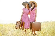 Free Girls With Suitcases At Countryside. Royalty Free Stock Photography - 20276727