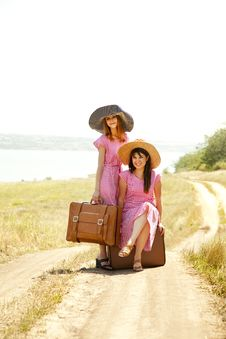 Free Girls With Suitcases At Countryside. Stock Photo - 20276760