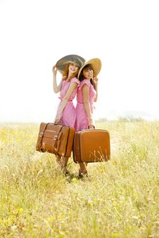 Free Girls With Suitcases At Countryside. Royalty Free Stock Photo - 20276765