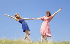 Happy Girls At Meadow. Royalty Free Stock Photography