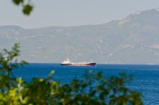 Free Cargo Ship Near Mountain Coast Stock Image - 20277311