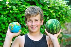 Boy With A Watermelon And A Globe Royalty Free Stock Photo