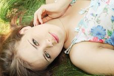 Free Girl Lies On Grass Royalty Free Stock Images - 20278419