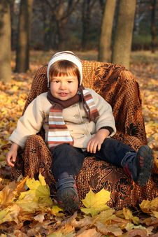 Free Little Boy Sitting In Chair Outdoors Royalty Free Stock Photos - 20279578