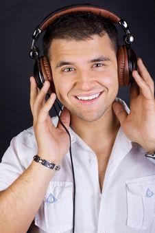 Free Handsome Man Enjoying Music On Headphones Stock Photography - 20279842