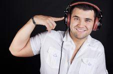 Free Handsome Man Enjoying Music On Headphones Royalty Free Stock Photography - 20279877
