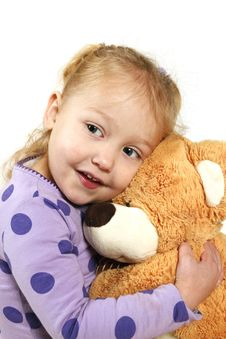 Free Little Girl Hugging A Teddy Bear Royalty Free Stock Images - 20279979