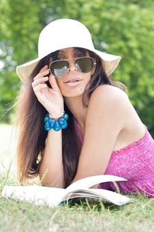Free Intellectual Woman Reading Book In The Park Royalty Free Stock Image - 20283306