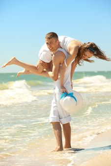 Young Couple Having Fun On The Beach Royalty Free Stock Images