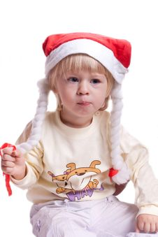 Free Little Girl In A Christmas Hat With Braids Royalty Free Stock Photo - 20286295