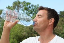 Free Man Drinking Water From Bottle Royalty Free Stock Photography - 20289877