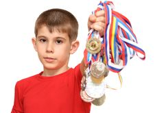 Free Boy-athlete With Medals Stock Photography - 20291072