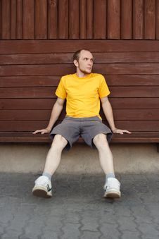 Free Man In Yellow Shirt Sitting On Bench Royalty Free Stock Photos - 20291448