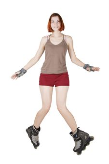 Girl On Rollerblades Making Trick Isolated Stock Photo
