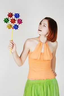Free Girl In Bright Clothes Holding Pinwheel Stock Image - 20291501