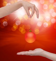 Free Human Hand Holding Transparent Christmas Ball. Royalty Free Stock Images - 20291509