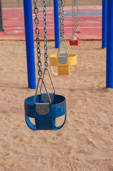 Free Colorful Empty Swings In Sand Stock Images - 20291914