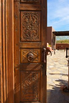 Free Wooden Ornate Opened Door With Stone Courtyard Royalty Free Stock Images - 20291919