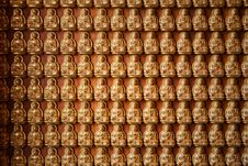 Golden Buddha State On Wooden Floor Royalty Free Stock Image