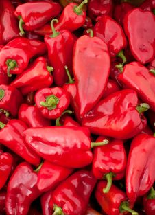 Background Of Many Big Red Peppers Stock Images