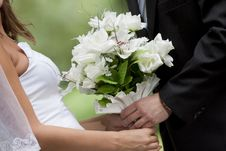 Bride Holding Wedding Bouquet Stock Images