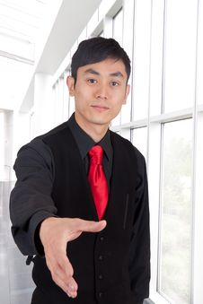 Free Hip Asian Man With Hand Out Royalty Free Stock Photography - 20297677