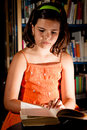 Free Young Girl Reading In Library Royalty Free Stock Photo - 20308155