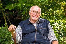 Portrait Of Elderly Man Sitting Stock Photo