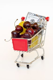 Free Shopping Cart With Fruts And Dollar Stock Photography - 20304222