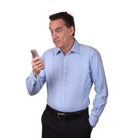 Free Attractive Man Looking Startled At Phone Stock Photography - 20304302