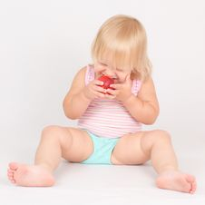 Free Adorable Girl Eat Red Fresh Peach Sitting On White Stock Photography - 20304382