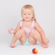 Free Adorable Girl Eat Red Fresh Peach Sitting On White Stock Photo - 20304450